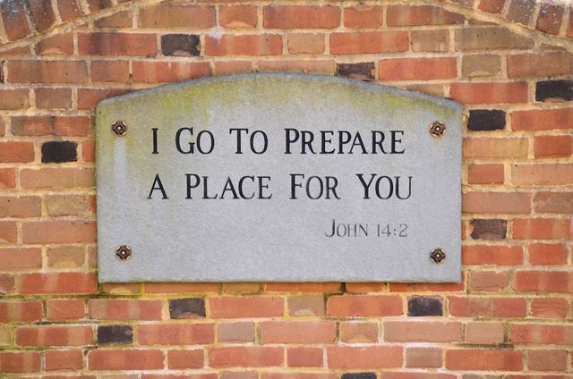 a sign on a building: I go to prepare a place for you.